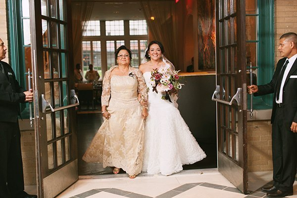 mother walking daughter down the aisle